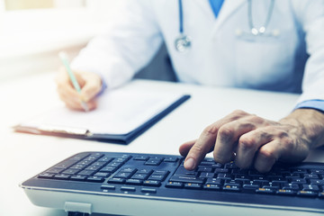 doctor working on computer in clinic office