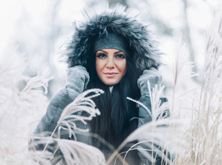 Beautiful woman wearing a fur hood winter coat
