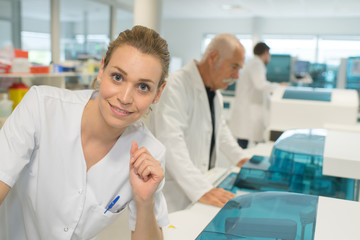 happy female doctor with lab coat