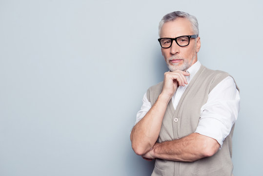 People scientist occupation concept. Portrait of confident clever serious pensive planning thinking collector realtor beige waistcoat rolled-up sleeves black rim-glasses isolated on gray background