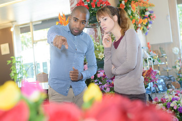 pointing at a bouquet