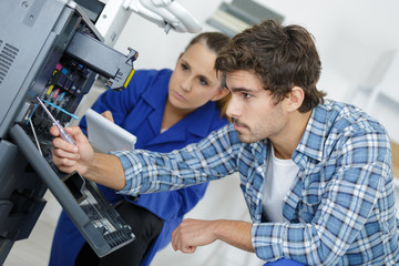 head technician inspecting the repair