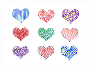Hand drawn hearts of various colors of ink on paper.