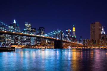 Skyline at night of New York City and Brooklyn Bridge