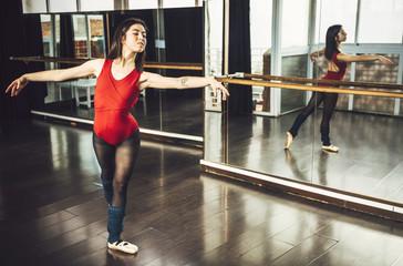 Woman in ballet pose in studio