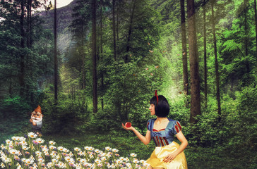 Snow White in a mysterious forest holds an apple in her hand. Artistic processing. Fotomurales