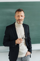 Attractive professor or teacher in a classroom
