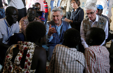 U.N. High Commissioner for Refugees Filippo Grandi and U.N. Under-Secretary-General for Humanitarian Affairs and Emergency Relief Coordinator Mark Lowcock talk to a newly arrived South Sudanese family at the Kakuma refugee camp in Turkana county