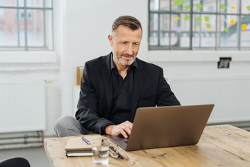 Businessman sitting working in a large office