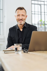 Businessman sitting at an office table