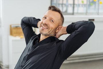 Confident relaxed businessman smiling at camera