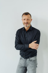 Confident relaxed middle-aged man