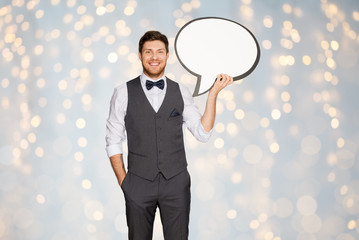 happy man in suit holding blank text bubble banner