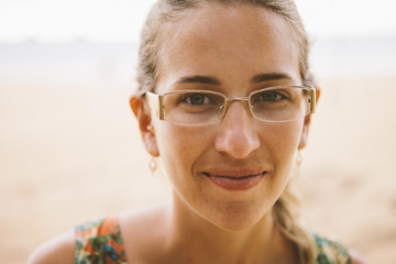 Close-up portrait of smiling woman at beach