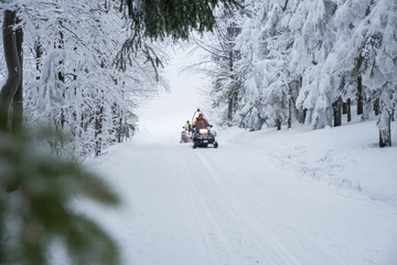 Man and snowmobile, white frozen winter nature