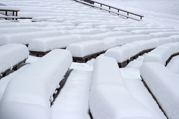 Snow on benches after a snowfall