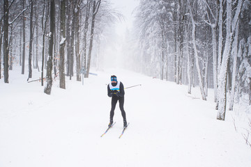 Professional nordic skier in white winter nature