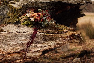 Autumn wedding bouquet on a branch