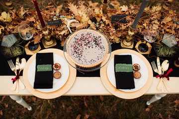 Wedding table decor with candles and pies
