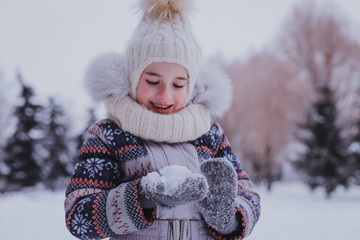 girl playing with snowball