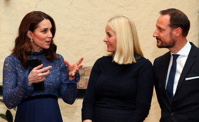 Britain's Catherine, the Duchess of Cambridge speaks to Crown Prince Haakon and Crown Princess Mette-Marit of Norway, during a visit to 'MESH', a work-space for start-up tech companies in Oslo