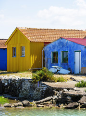 alignment of colored fisherman cabins on the seaside