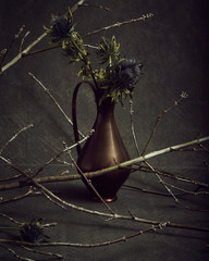 Still life with thistle in vase