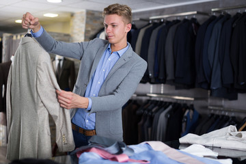 man buyer choosing jacket