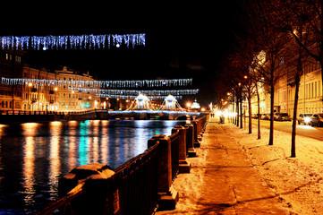 decoration Lomonosov bridge across the Fontanka river in Saint Petersburg - night view