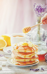 Pancakes with honey and butter. Selective focus.