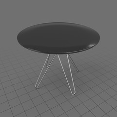 Outdoor table with curved legs