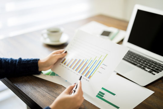 Woman reviewing financial reports