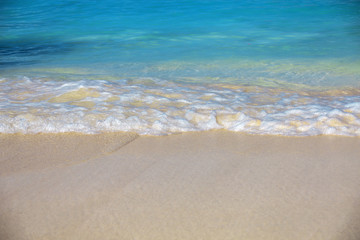 sea surf, blue clear water and white sand