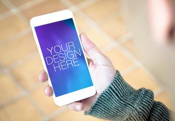 Smartphone Mockup with Hand on Tile Floor Background