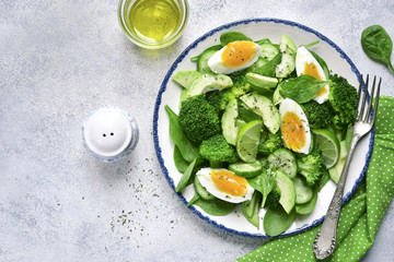 Spring avocado salad with green vegetables and boiled egg.Top view.