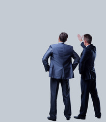 Two businessman looking at white background.
