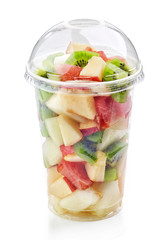 fresh fruit pieces salad in plastic cup