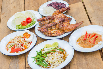 Grilled chicken, Papaya salad or Som Tum, Pad Thai, Kanom Jeen or rice vermicelli, Lap Moo or Pork spicy Thai style famous local the eastern delicious food of Thailand.