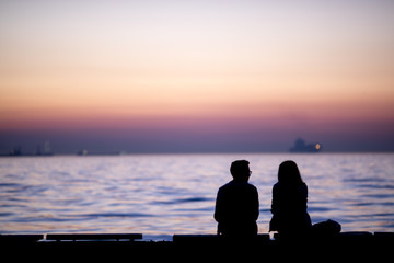 Couple looking with sunset
