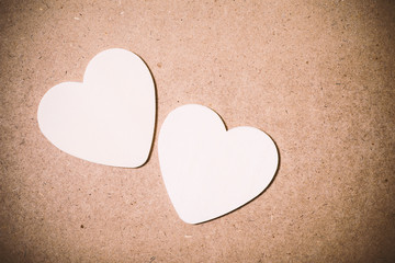 White hearts shape on brown background, Valentine day concept