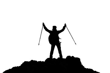 Silhouette of winner on the top of the mountain, hands up, with walking sticks