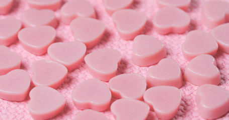 Chocolate candy on pink background