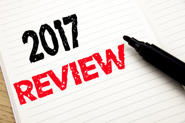 2017 Review. Business concept for Annual Summary Report written on notebook with copy space on book background with marker pen