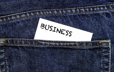 Business card in trouser pocket