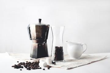Arabica coffee in moka pot On a white background