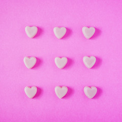valentine candy hearts shape on pink background