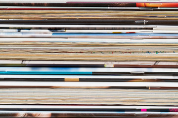 A stack of old magazines. Closeup
