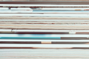 A stack of old magazines. Closeup, toned