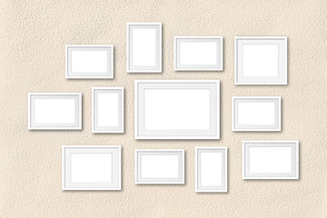 Collage of white blank photo frames on painted wall background, interior decor mockup, 3d illustration