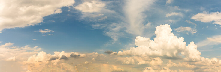 Fantastic panoramic white clouds against blue sky